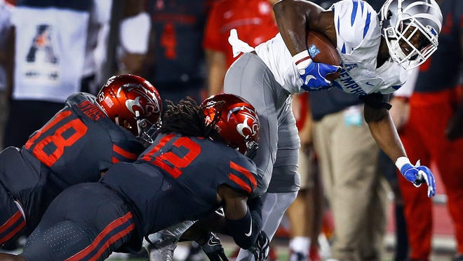 University of Memphis receiver Anthony Miller (right) fights for a first down against the University of Houston defense during third quarter action in Houston, Texas., Thursday, October 19, 2017.