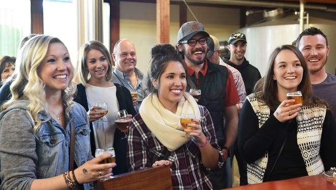 Alyssa Stein, Megan Couper, and Danielle Sheehan laugh with their tour guide at New Belgium Brewing Company in 2016.