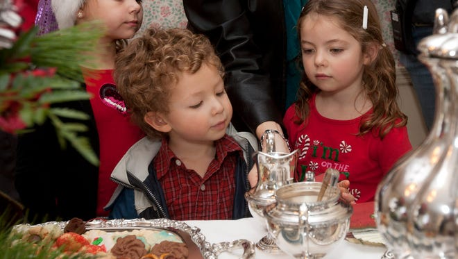 Helena and James Jaeger and Mikeila Koenning enjoy a past edition of the Silver Tea and Christmas Cookie Sale at the Old Falls in Menomonee Falls. This year's event is set for Sunday, Dec. 3.