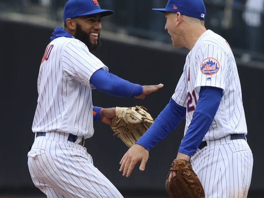 Amed Rosario and Todd Frazier celebrate at the end