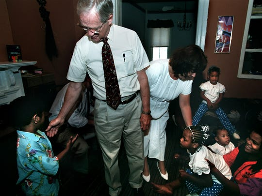Bill Goodling and Holly Morgan visit with the children of Vivian and Nykia Bristol on South Pine Street in York MondayJune, 24, 1996.