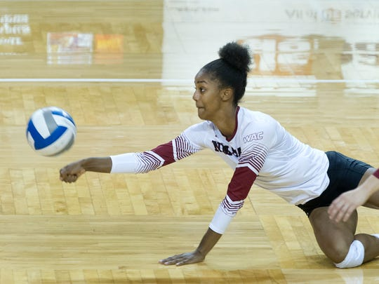 New Mexico State junior Tatyana Battle dives for a