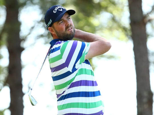 Marc Leishman hits his tee shot on the 4th hole during
