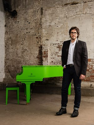 Josh Groban is helping to auction off a Kermit-green Yamaha grand piano for charity.