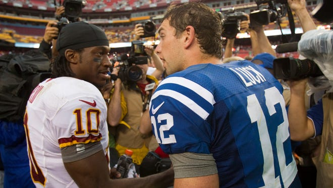 The top two picks from the 2012 NFL draft: Robert Griffin III (left) and Andrew Luck (right).