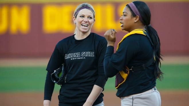 Jan. 28, 2014 - ASU pitcher Mackenzie Popescue talks with catcher Amber Freeman.