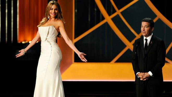 Sofia Vergara, left, and Television Academy CEO Bruce Rosenblum speak on stage at the 66th Annual Primetime Emmy Awards at the Nokia Theatre L.A. Live on Monday, Aug. 25, 2014, in Los Angeles.
