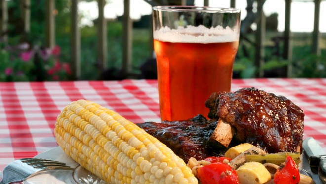 Perfect holiday barbecue, complete with baby back ribs, corn on the cob, vegetables, and a wonderful wheat pale ale.