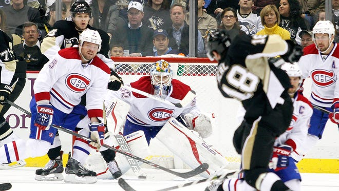 Peter Budaj #30 of the Montreal Canadiens makes a save on James Neal #18 of the Pittsburgh Penguins during the game at Consol Energy Center.