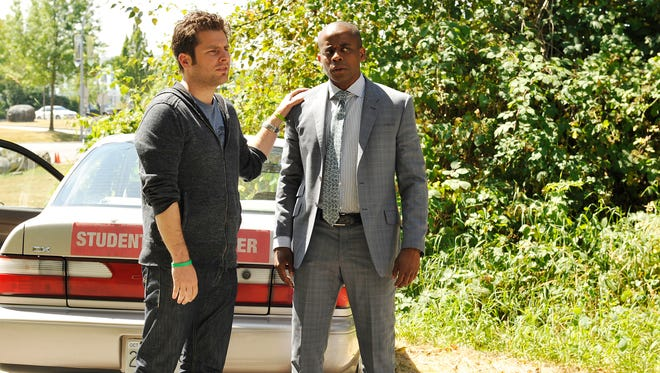 """""""There's not a lot of shows out there where a teenager is cool sitting in front of the TV with his parents for an hour, admitting that they're enjoying the same content,"""" says star James Roday, left, with 'Psych' co-star Dulé Hill. """"We somehow managed to pull that off."""""""