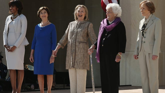 First lady Michelle Obama, former first lady Laura Bush, former first lady Hillary Clinton, former first lady Barbara Bush and former first lady Rosalynn Carter attend the opening ceremony of the George W. Bush Presidential Center April 25, 2013, in Dallas.