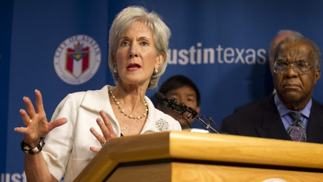 Secretary of Health and Human Services Kathleen Sebelius, left, speaks at a news conference at City Hall in Austin, Texas