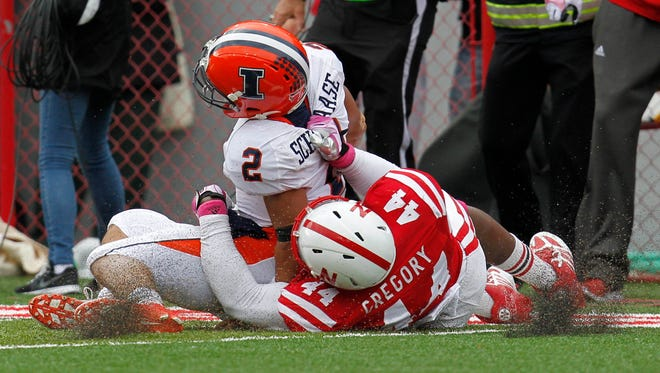 Nebraska defender Randy Gregory (44) tackles Illinois quarterback Nathan Scheelaase (2) during the fourth quarter of a 39-19 win Saturday at Memorial Stadium in Lincoln, Neb.