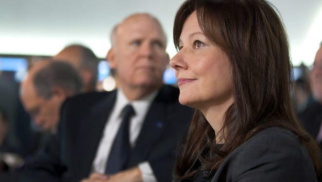 General Motors Executive Vice President Mary Barra will be GM's next CEO, succeeding Dan Akerson, seen behind her in this 2012 photo