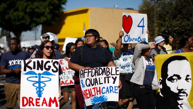 Supporters of the Affordable Care Act march in the Kingdom Day Parade on Jan. 20 in Los Angeles.
