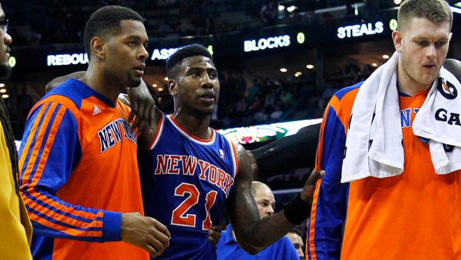 Knicks shooting guard Iman Shumpert, center, is helped off the court after being injured during the second half against the New Orleans Pelicans on Wednesday.