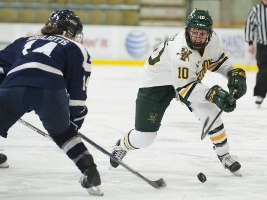 Vermont's Mackenzie MacNeil (10) skates with the puck