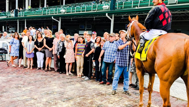 I'm a Looker in the Churchill Downs winner's circle.