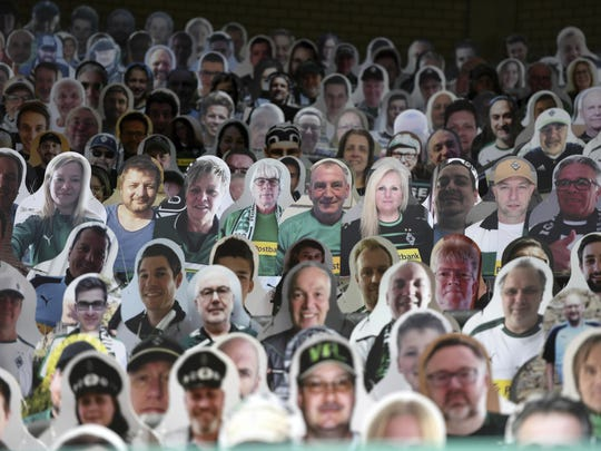 Cardboard pictures of fans ahead the German first division Bundesliga football match Borussia Moenchengladbach and Bayer 04 Leverkusen Saturday in Moenchengladbach, western Germany.