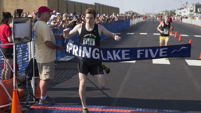 Justin Scheid of Succasunna takes first place in 25:29.9 at the Spring Lake Five on Saturday.