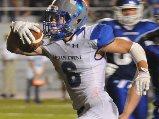Cedar Crest's Tate Seyfert runs for a touchdown against