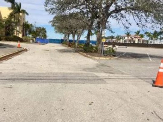 A judge may have to decide whether use of the site of a planned Fort Myers hotel as a parking lot will stave off any effort to force the site to be given to the descendants of the couple who sold the land to the city on the condition it not be used for a park.