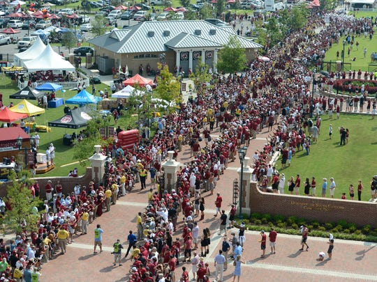 Before every game, fans march to the stadium along with Cocky, the Gamecocks mascot and the University of South Carolina football team.