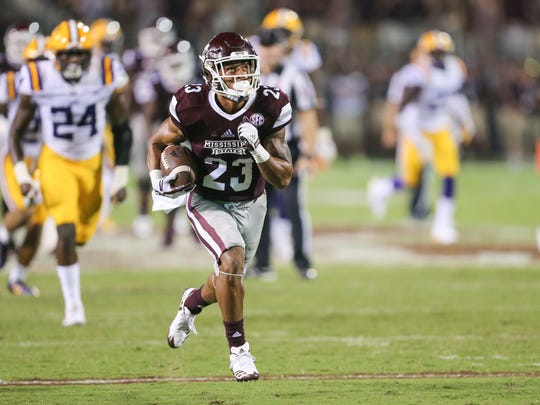Mississippi State's Keith Mixon (23) runs away from