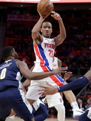 Pistons guard Avery Bradley passes during the first