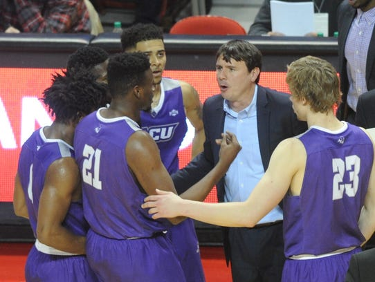 ACU coach Joe Golding talks to his team during a time