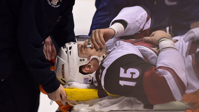 Coyotes forward Brad Richardson (15) is carried off on a stretcher after a hit by Canucks defenseman Nikita Tryamkin (not pictured) on Nov. 17.