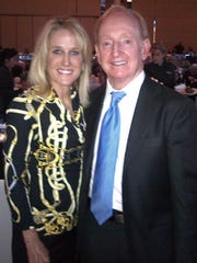 Tennis legends Tracy Austin, left, and Rod Laver pose