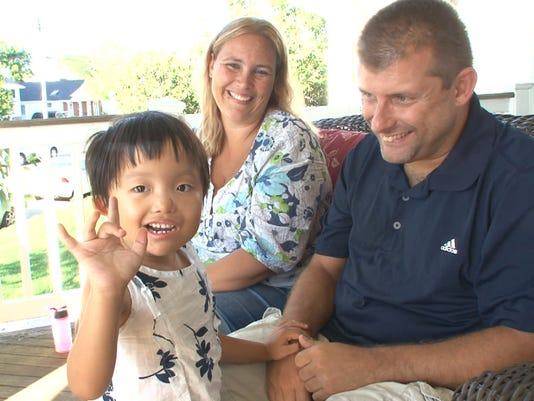 Chinese girl adopted by deaf couple