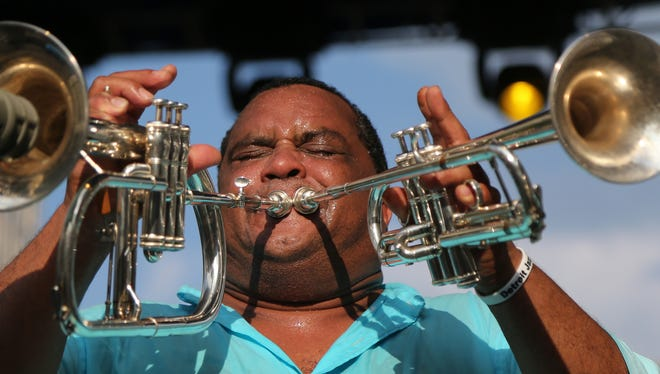 Sax player Roger Lewis for The Dirty Dozen  performs during the Detroit Jazz Festival at Hart Plaza on Sunday, Aug.31, 2014.