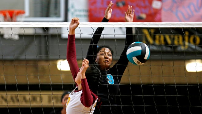 Navajo Prep's Leshauntai Adams (9) blocks a hit on Saturday during a game against Rehoboth Christian at the Eagles Nest in Farmington.
