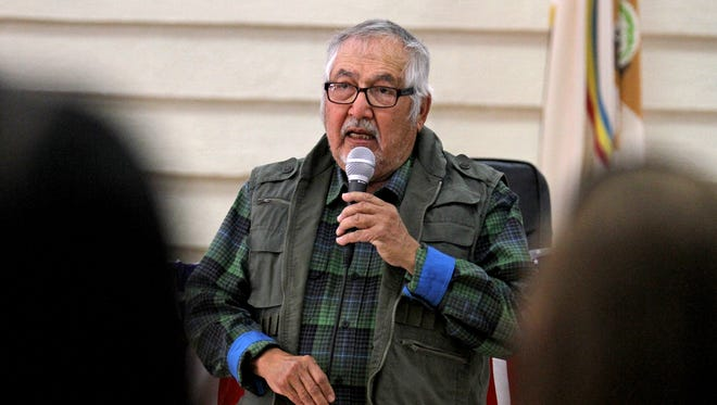 Gilbert Harrison Sr., a farm board official for the Gadii'ahi-Tokoi Chapter and president of the San Juan River Farm Board, speaks Monday about losses resulting from the Gold King Mine spill during a public meeting at the Shiprock Chapter house.
