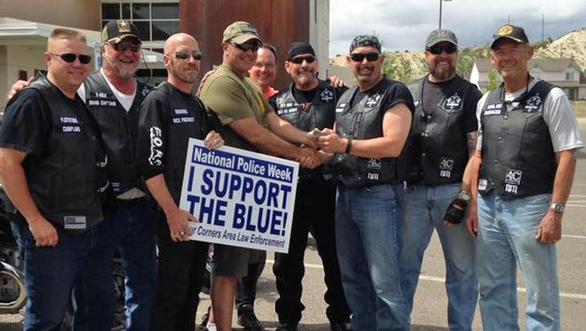 The Four Corners Chapter of the Armaduras Law Enforcement Motorcycle Club raised more than $800 for a local combat veteran, retired New Mexico National Guard Master Sgt. David Montoya. Members of the club presented the money to Montoya on May 14 at the Bloomfield Police Department.