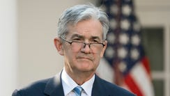 Jerome Powell listens to  President Trump (not pictured)