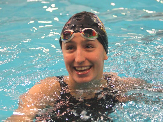 Cora Dupre, a Mariemont junior, smiles after winning