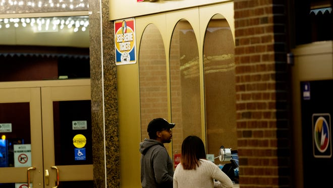 Patrons outside of the box office at the downtown Regal Cinema on Gay Street in Knoxville, Tennessee on Thursday, October 26, 2017.