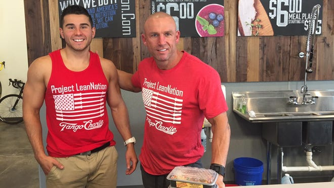 Morgan Barden stands with Project LeanNation owner Tom Dougherty, right. Dougherty has expanded his healthy meal-planning business into retail space in Tops Plaza in Brighton.