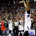 Atlanta Hawks' Kyle Korver, center, celebrates along with teammate Al Horford, right, as the Hawks beat the Washington Wizards 82-81 in Game 5 of the second round of the NBA basketball playoffs Wednesday in Atlanta.
