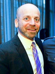 Alan Mucatel, executive director of Rising Ground