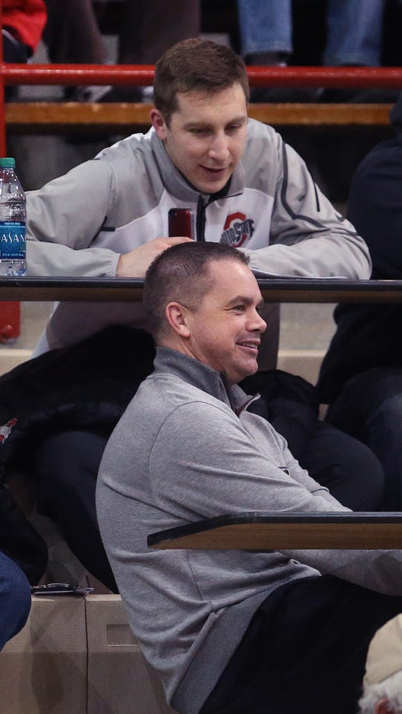 Butler's Chris Holtmann (foreground) and Ohio State assistant Greg Paulus (top) watch the action between Southport and Park Tudor, Jan. 14, 2015.