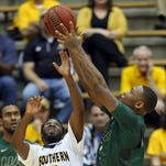 Southern Miss Golden Eagles guard Khari Price (5) and UAB Blazers forward Chris Cokley (3) fight for the ball in the first half at Reed Green Coliseum. Mandatory Credit: Chuck Cook-USA TODAY Sports