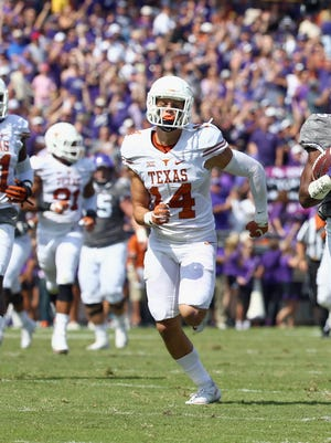 Texas Longhorn Dylan Haines #14 chases down a TCU defender in the second quarter of Saturday's game.