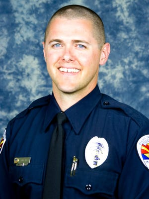 Chandler Police Officer Bryant Holmes died on Oct. 28, 2014.