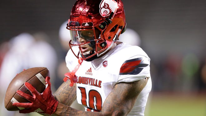 Louisville's Jaire Alexander (10) warms up prior to an NCAA college football game against North Carolina State in Raleigh, N.C., Thursday, Oct. 5, 2017. (AP Photo/Gerry Broome)