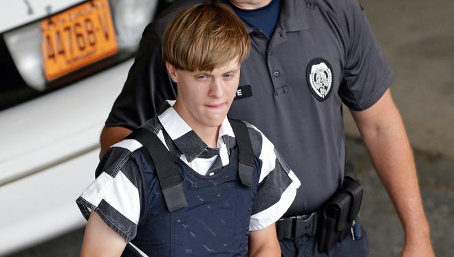FILE - In this June 18, 2015 file photo, Charleston, S.C., shooting suspect Dylann Roof is escorted from the Cleveland County Courthouse in Shelby, N.C. A federal jury has sentenced Roof to death for killing nine black church members in a racially motivated attack in 2015.