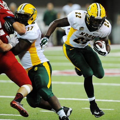 North Dakota State's King Frazier (22) rushes with the ball during the second half of a game against USD on Saturday, Oct. 25, 2014, at the DakotaDome in Vermillion, S.D. The Bison defeated the Coyotes 47 to 7.